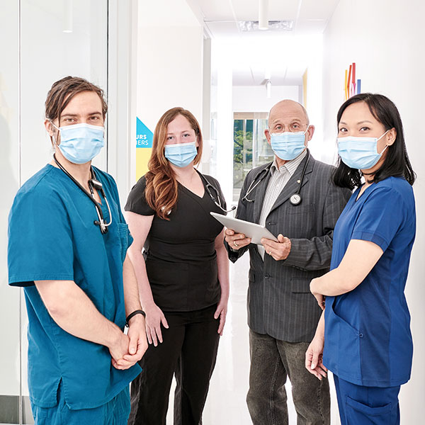 A group of Santé Cannabis's health care professionals and doctors standing together as a clinical team