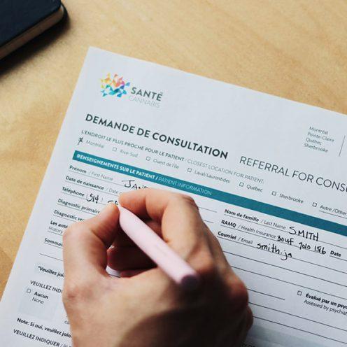 A patient filling out a referral form at Santé Cannabis